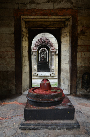 reincarnation: Stone Shiva lingam in Pashupatinath temple complex on Bagmati River in Kathmandu valley, Nepal Editorial