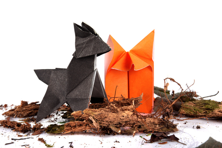 Origami Wolf And Fox Isolated Over White Background Stock Photo