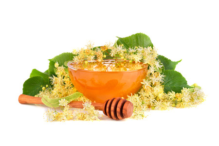 Fresh honey with linden flowers isilated on white background Stock Photo