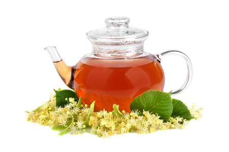 Herbal tea with linden flowers and fresh honey on a white background