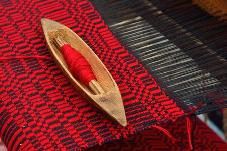 Detail of vintage belorussian weaving loom with wool close up