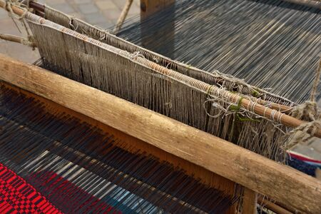 Part of traditional vintage belorussian weaving hand loom with wool close up