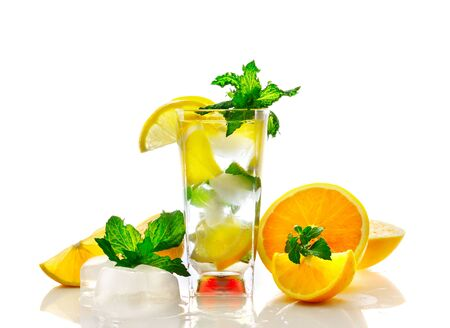 Lemon and orange cocktail with mint leaves in glass on white background