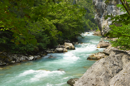 range of motion: mountain river flowing among the rocks