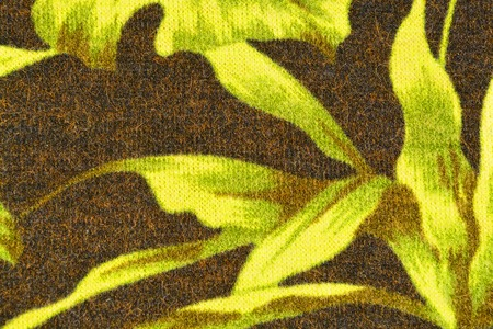 woolen cloth: The background of dark woolen cloth with green leaves closeup