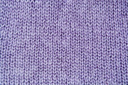 counterpane: Lilac color wool knitted background close up Stock Photo