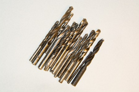 diameters: a group of drill bits of different diameters on a white background Stock Photo
