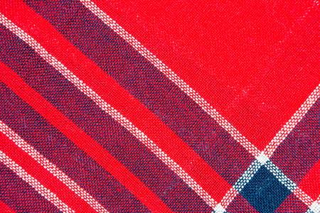 tejido de lana: La textura de un tejido de lana a cuadros rojo y azul