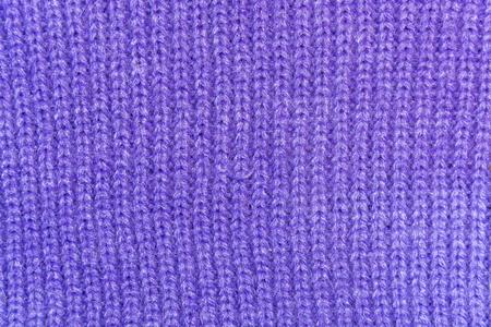tejido de lana: La textura de un tejido de lana de color púrpura de cerca de punto
