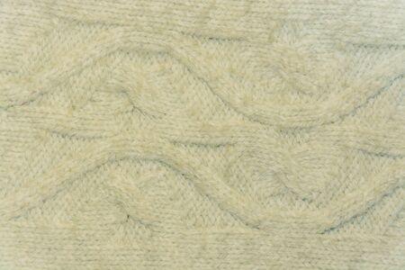 tejido de lana: el primer blanco de la tela de lana con motivos Foto de archivo