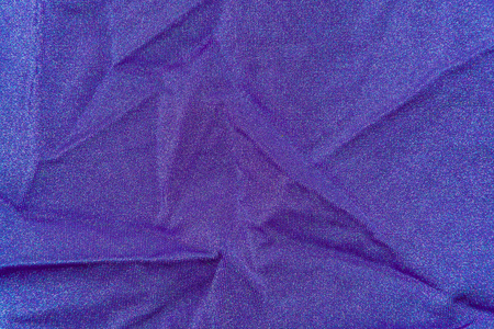 lycra: background, texture of fabric draped purple lycra