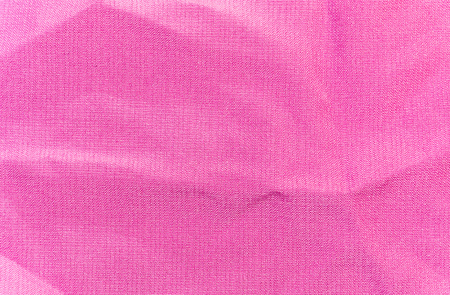 The background, texture of crumpled pink silk fabric