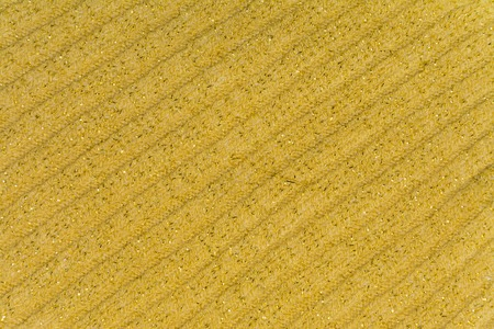lurex: The background, texture of striped knitted fabric colors ocher yellow with lurex
