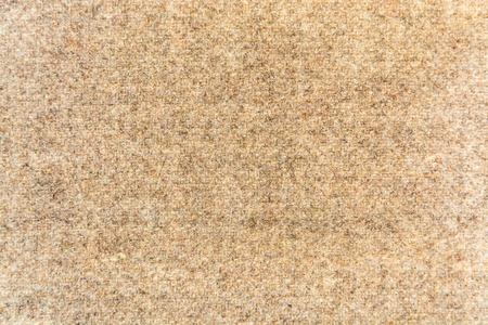woolen fabric: tejido de lana de color beige para el fondo