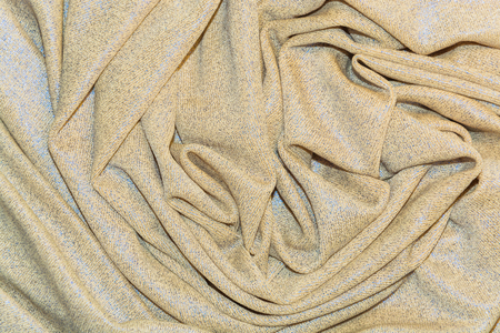 draped: The draped beige and blue knitted fabric for the background Stock Photo