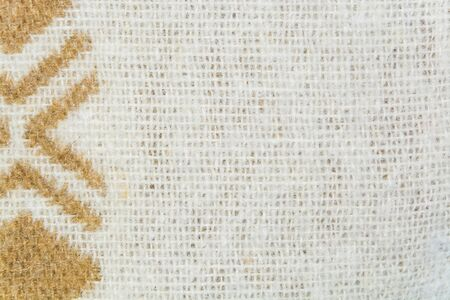 texture twisted: The texture of white woolen yarns twisted with brown ornament closeup