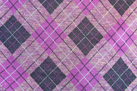 Texture, background of a tartan purple fabric