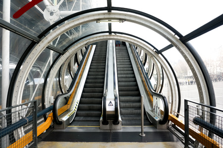 escalator up and down with tunnel in modern building