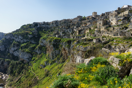 ancient ghost town of Matera (Sassi di Matera) in beautiful sun shine with blue sky, southern Italy Stock Photo