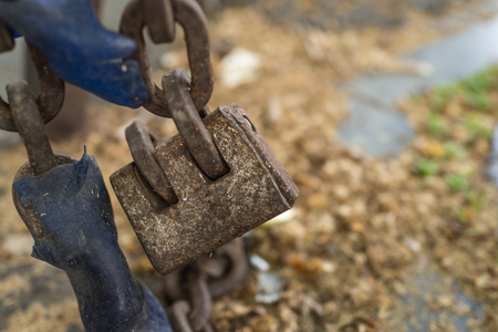 Closed up of old padlock chain lock as safety and security or eternity concept
