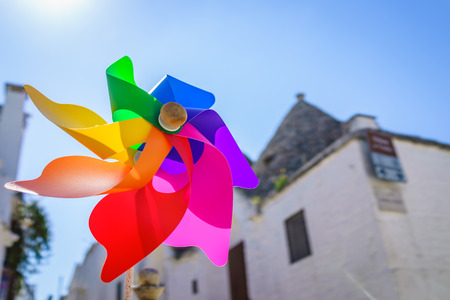 rainbow sky: Closed up shot of colorful rainbow pinwheel in sun shine summer day.