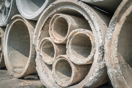 Stack of concrete drainage pipes prepare for underground construction. Stock Photo