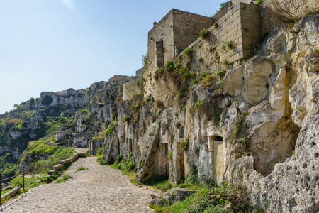 The ancient ghost town of Matera (Sassi di Matera) in beautiful sun shine with blue sky, southern Italy.