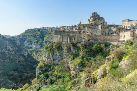 ancient ghost town of Matera (Sassi di Matera) in beautiful sun shine with blue sky, southern Italy.