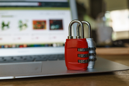 Computer security concept, with combination lock pad with the background of computer website.
