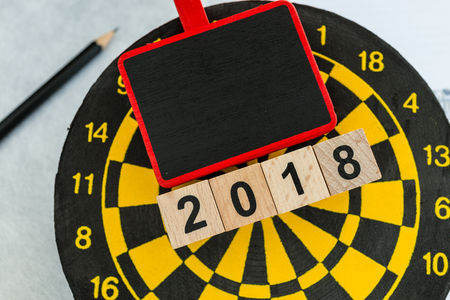 Year 2018 planning target concept with wooden blocks number 2018 on dart board with copy space. 스톡 콘텐츠