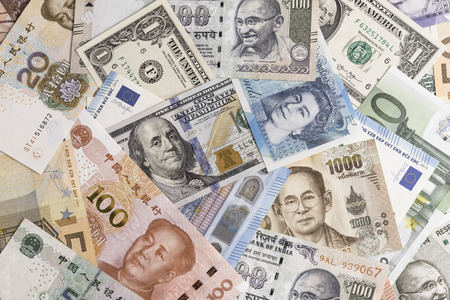 International banknotes from world major countries using as Forex or financial economy background, US dollar, UK pound, Euro, Japanese yen, Indian rupee, Chinese yuan, Thai Baht. 스톡 콘텐츠