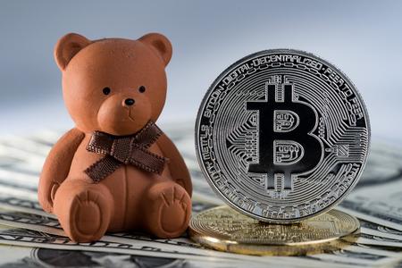 Bear doll with bitcoin crypto coin using as Bitcoin bear market trading. Stock Photo