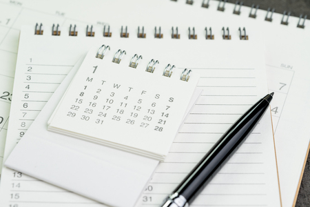 Calendar planner page on notebook list with a pen using as reminder or year plan appointment.