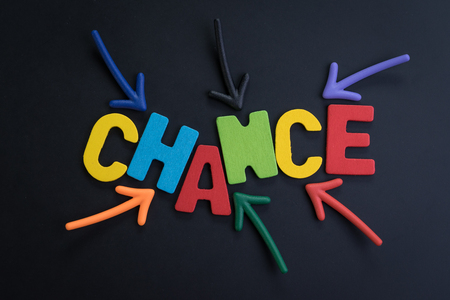 Concept chance in life or career path, job or work journey, colorful arrows pointing to the word CHANCE at the center on black chalkboard, motivation for life target or success in work.