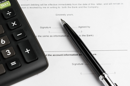 Financial money loan, mortgage or buy and sell contract with bank, printed paper form with pen to sign and calculator.