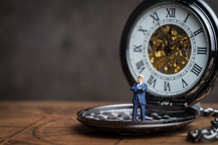 Time prove for business success concept, miniature people leadership businessman standing on vintage pocket mechanical watch, can be use for future career path.