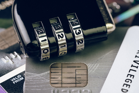 Credit card online payment data security concept, combination code lock pad on pile of credit cards, e-commerce safety encode to transmit data. 스톡 콘텐츠