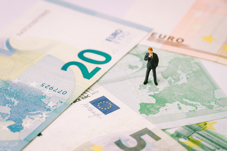 Europe, Brexit or Britain economy or financial concept, miniature figure businessman country leader standing on United Kingdom map on Euro banknote.