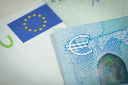European economy, financial, investment or currency exchange concept, closed up shot of Euro sign symbol with Euro flag on Euro banknotes. Imagens