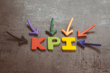 KPI, Key Performance Indicator business target and goal management concept by multiple arrow pointing to colorful alphabet acronym KPI at the center on chalkboard.