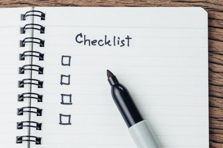 Checklist with marker pen and check box on small notepad on wood table, to do list, prioritize or reminder for project or plan. Reklamní fotografie