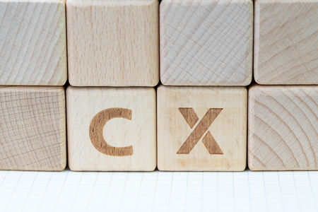 Important of user centric in recent world business, product and service with Customer Experience concept, cube wooden block with alphabet CX. Stock Photo