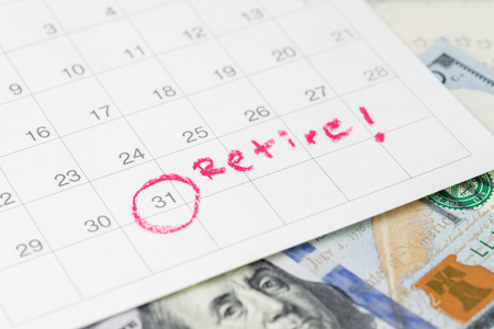 White clean calendar with circle at date and handwriting text as Retire on US dollar banknote using as success in investment, deadline or planning for retirement of office salary man. Stock Photo