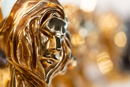 Closed up of gold Cannes lion award, trophy for winner of advertising agency in yearly festival in Cannes, France.