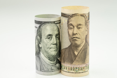 Japan and USA, United State America relationship or economics world major countries concept, Japanese Yen and US Dollar banknote role on white background. Stock Photo