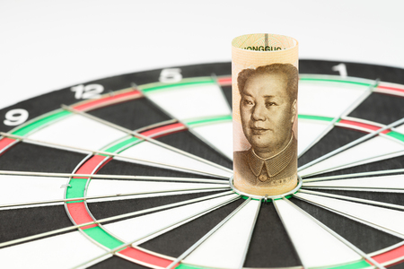 Target for trade war and tariff with China, major country world economy import and export trade policy, Chinese Yuan bank roll targeted at the center of yellow dartboard.