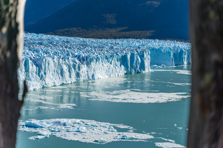 Amazing view of Perito Moreno glacier, blue iceberg glacier from peak of the mountain through the aqua blue lake in Los Glaciares National Park, Santa Cruz, Argentina, southern Patagonia ice field.