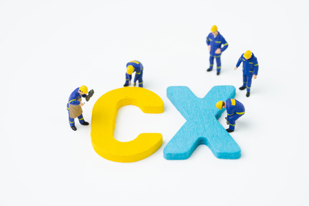 CX, Customer Experience concept, miniature figure worker building alphabet CX at the center, important of customer centric experience design in recent world business, product and service.