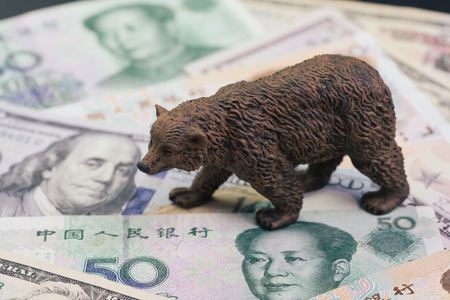 US and China trade war and tariff impact to bear market, price drop in stock concept, bear figure walking on pile of United States and Chinese banknotes, world most financial influence countries.