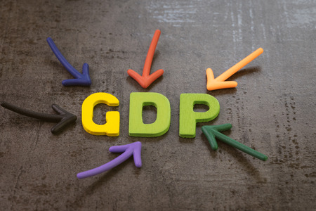 GDP, Gross Domestic Product concept, the primary indicators used to gauge the health of a country's economy, arrow pointing to abbreviation word GDP on blackboard.